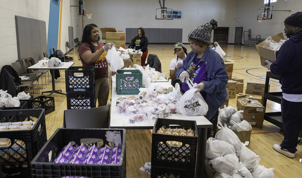 Volunteers help distribute food