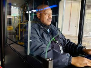 DDOT bus driver behind barrier